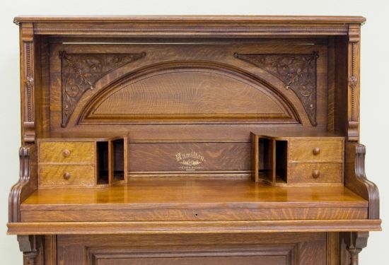 Another piano desk. Tucking that keyboard out and sliding the front panel back while ensuring that the carvings remain intact requires focus and accuracy.