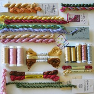 Threads shown here include Belle Soie, Water Lily 12-ply thread from the Caron Collection, Dinky Dyes hand-dyed silk, Soie d' Alger and Soie Gobelins thread.  - © Cheryl C. Fall, Licensed to About.com
