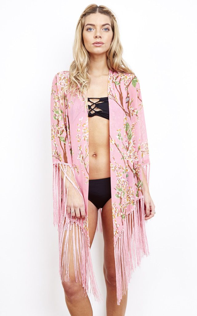 Pretty pink tassel kaftan that is perfect to wear over a bikini or swimsuit on the beach and can also be dressed up for a night out or festival.