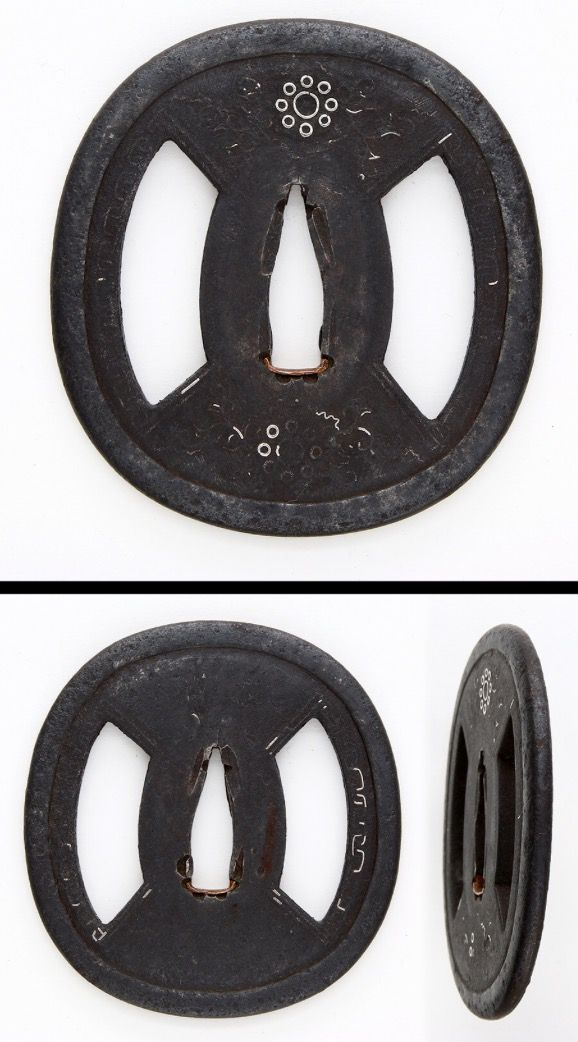Mid Kamakura period On the round shape iron tsuba, Kuyo mon family crest is inlayed by silver. Kuyomon family crest were used by Hosokawa, Soma and Date family. Menuki : men are engraved by syakudo plate with gold color. Attributed as Mogarasi school.
