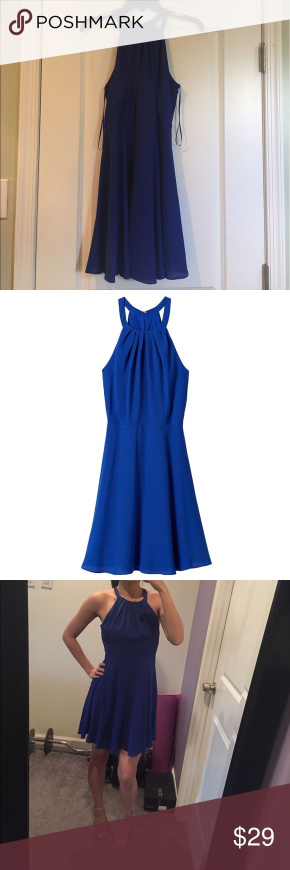 Express fit and flare halter dress Worn once. Like new. Royal blue color. Light crepe fabric, soft pleating and a flaring skirt give this bright blue halter dress lovely, rippling movement, as silky lining keeps you feeling luxe.  Modified halter neck, crisscross back w/ keyhole effect Sleeveless, hidden side zipper Pleated bodice, seamed waist Fully lined bodice and skirt, hits above the knee Polyester Machine wash Express Dresses Mini