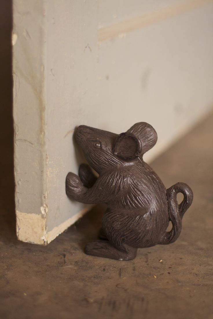 "This petite little mouse, made from cast iron and featuring charming details, will always stand ready to prop open your door or prop up your books. 4½"" x 5""t"