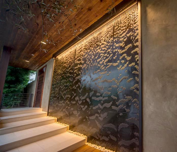 Recessed copper water wall in a private residence