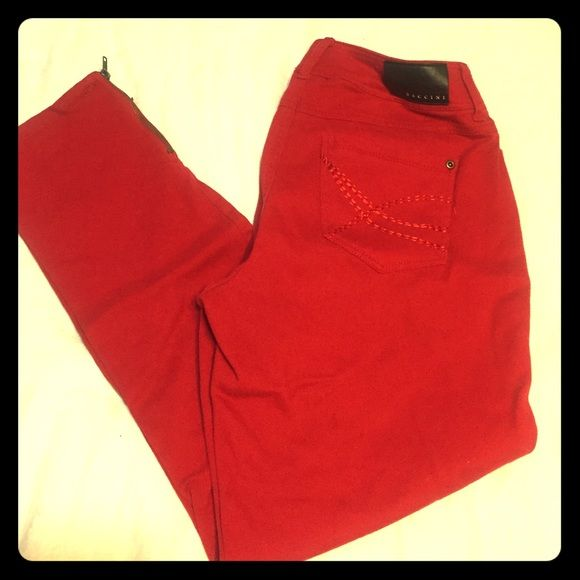 Hot red skinny pants w zip leg Excellent condition and well made. Very vivid red and sexy! Love these pants but too big for me Baccini Pants Skinny