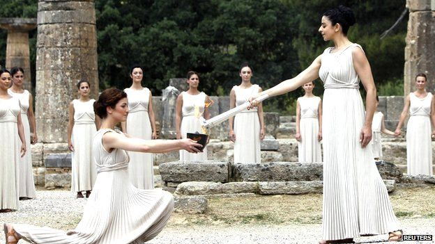 Olympic torch lit in traditional Greek ceremony. The Olympic flame is lit in a ceremony in Greece by actresses dressed in white robes