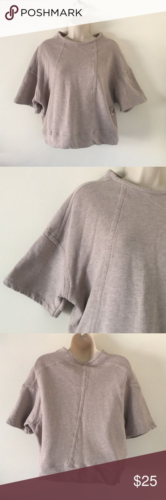 Zara W&B Coll.  oversize short sleeve sweatshirt 99 cotton 1 viscose. Slouchy short sleeve sweatshirt.  It's a Heather grey with slit brown tint. Meaning not completely a grey color. Very stretchy. Zara Tops Sweatshirts & Hoodies