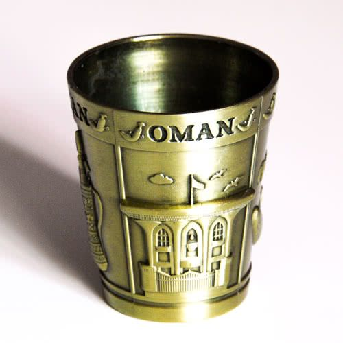 Shot Glass: Oman. Metal Short Glass. Main Attractions