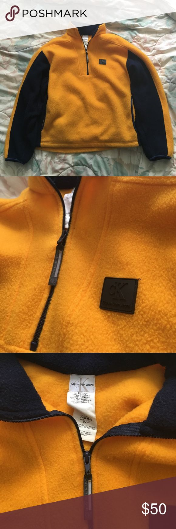 Calvin Klein Jeans pullover fleece vivid blue and yellow Calvin Klein pullover fleece will definitely have the honeys cozying up on you this season :-) only slight wear and tear is on zipper tag (pictured above) Calvin Klein Jeans Sweaters