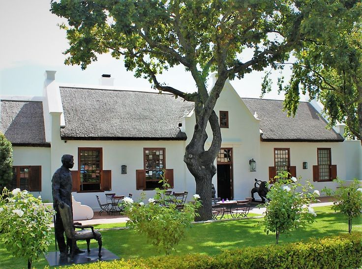 Franschoek, Cape winelands, statue of Mandela in front of lovely Cape Dutch house.