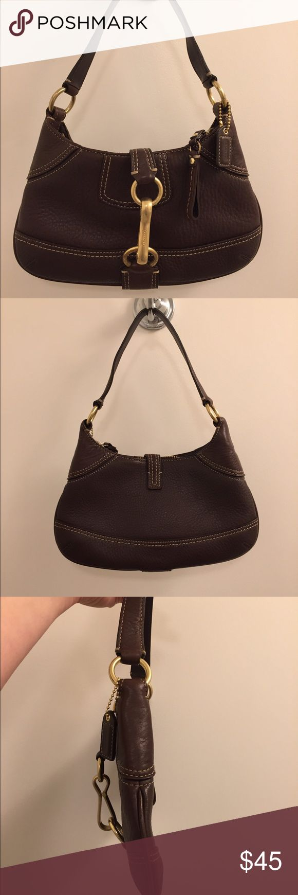 Brown leather Coach Hobo Bag Brown leather and brass accented Coach Hobo Bag.  Leather is in great condition but there is wear on the metal rings (as shown in the photographs). Coach Bags Hobos