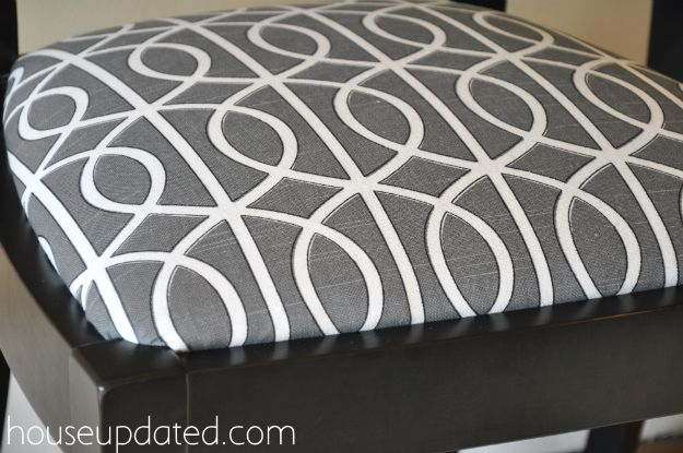 How to recover dining room chairs, this time with Dwell Studio Bella Porte Charcoal (gate) fabric. From drab to fab.