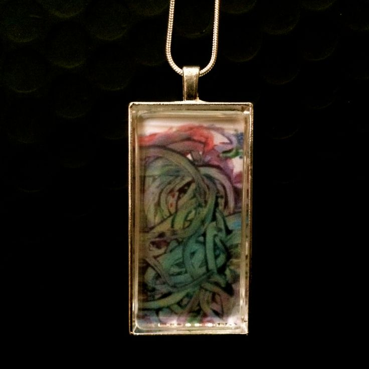 Finger paintings make great jewellery because kids are adventurous and brilliant with their colour choices.  http://sweetmemoryart.com/collections/custom-photo-jewellery/products/kid-art-jewellery