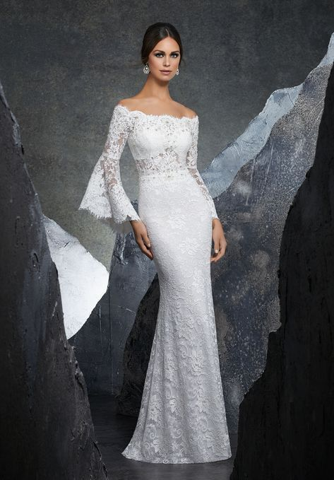 a95f89f91c3 This Mori Lee Blu 5605 Kiersten fitted bridal gown is styled in beaded lace