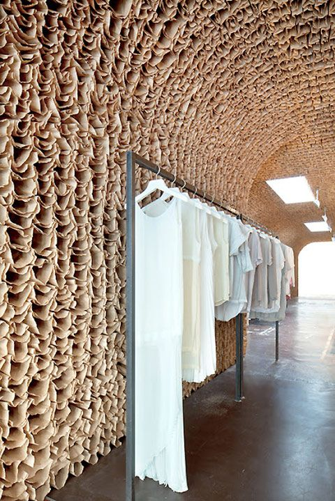 Check out this store with the walls and ceiling covered in brown paper bags! Forget about all the dust and dirt that it will collect and you can't remove and enjoy the idea.  I mostly like the light at the end of what looks as a tunnel store