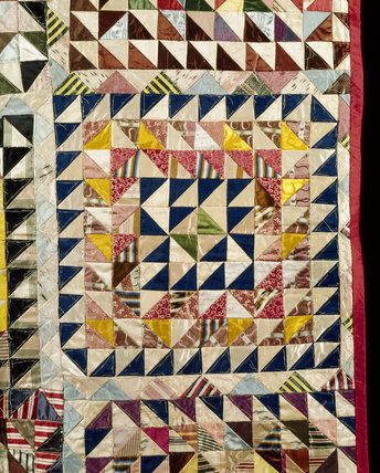 A detail of the patchwork quilt from the Quantoxhead Suite Bedroom at Dunster Castle