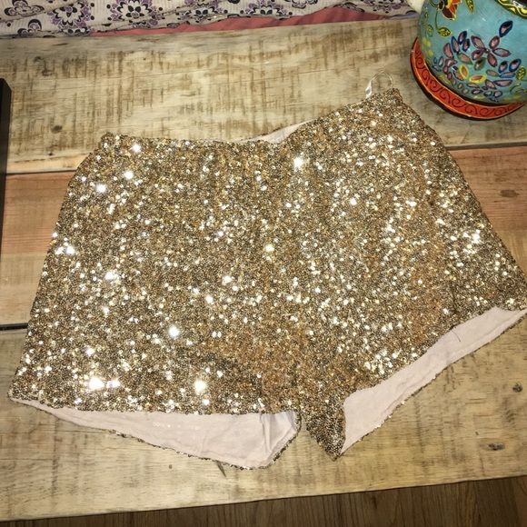 Gold sequin shorts Gold sequin shorts size Small. Has stretchy waistband ! Shorts