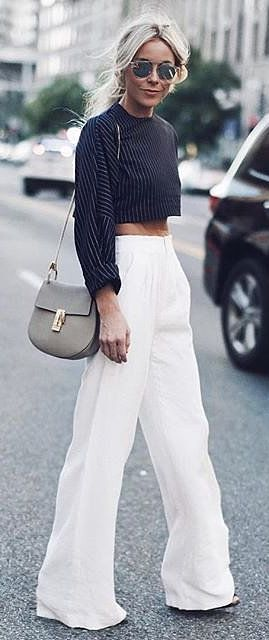 Wide leg pants, striped crop top, and neutral Chloé purse make for an effortlessly glam look.