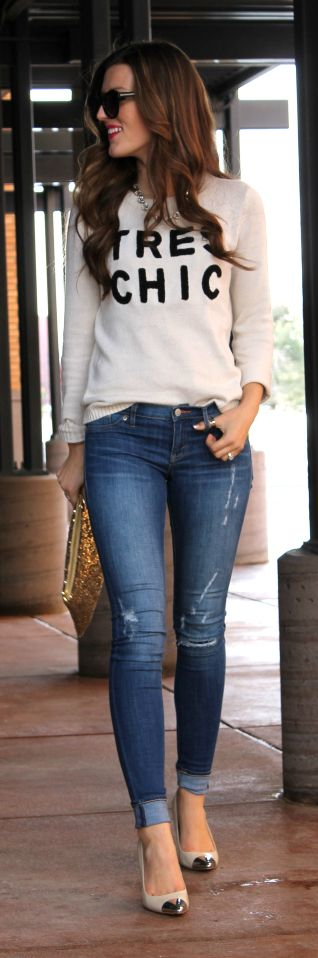 Black geek sweater or French creme sweater, jeans and nude pumps