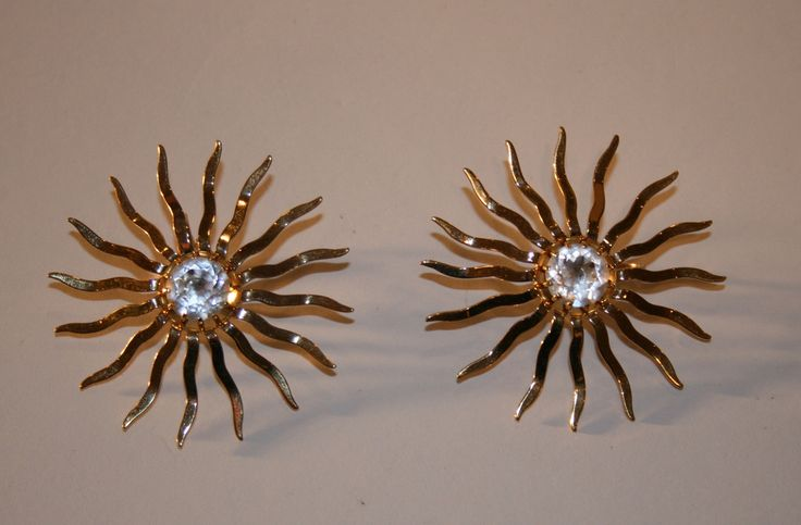 A burst of style and class in this pair of 1960s era earrings. A stylized…