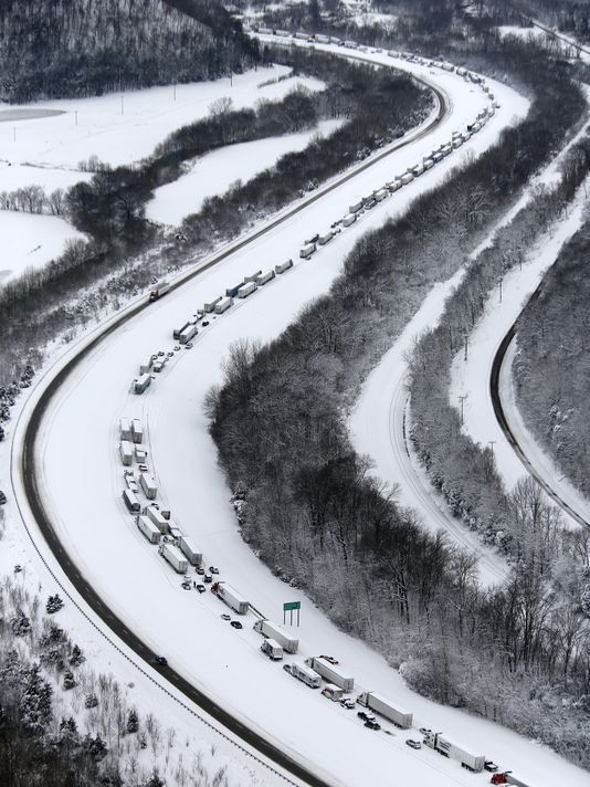 5 March 2015 - Winter Storm Thor: Record Two-Day Snowstorm - Cars remain on Interstate 65 southbound, after being stranded on the hill to Elizabethtown, Kentucky., the previous evening. A storm dumped up to 21 inches of snow. (Photo: Pat McDonogh, The (Louisville, KY) Courier-Journal)