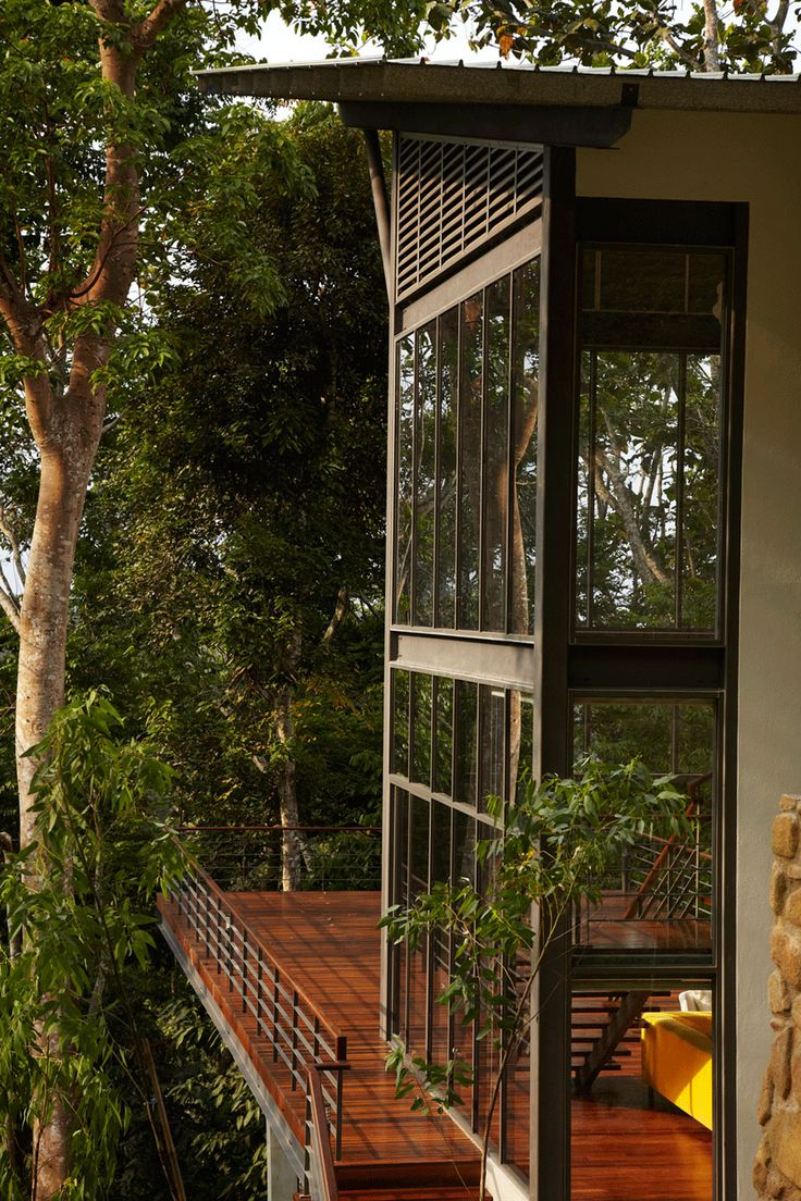 The Deck House was designed by Choo Gim Wah Architect and is located in Janda Baik, a small village in Pahang, Malaysia. The home is perched on a steep hill and surrounded by a lush forest, with an interior of rich wood floors and clear glass walls.              Drawing  Drawing  Photos by: Kenneth Lim, Gray Studio