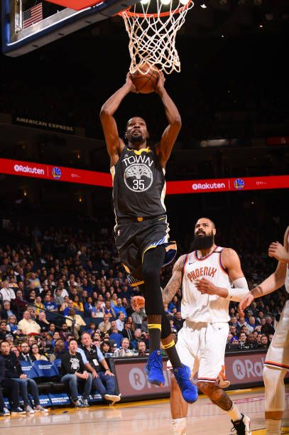 f8eb3d583b5 Kevin Durant of the Golden State Warriors dunks against Tyson Chandler of  the Phoenix Suns on February 12 2018 at ORACLE Arena in Oakland California.