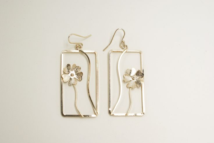 Sterling Silver handcrafted earrings. Flowers hand fabricated, wires approx 1mm thick.  Photo depicts actual variation in size of flowers.