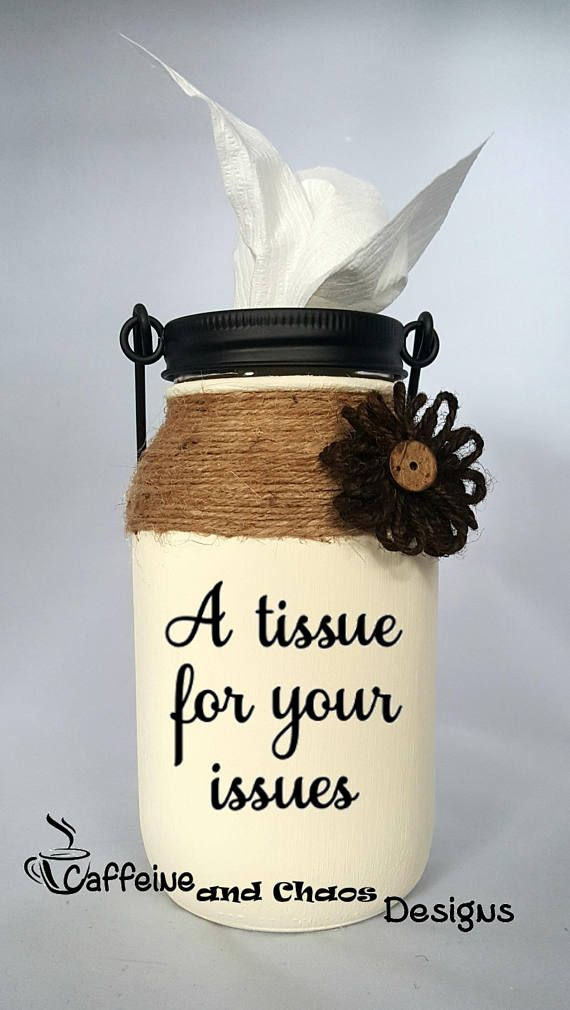 Upgrade your tissue holder to these hand painted mason jars with decorative star dispenser. Fits new Kleenex rolls for easy distribution. Tissue holder can also be hung if desired. Several color options available. Includes twine wrapped top of jar and either a burlap or silk flower to coordinate with paint color. Additional embellishment options available. Message us for details and pricing. Measures approximately 3.5 x 7 Lettering in black except for darker colors (black, nautical blue)…