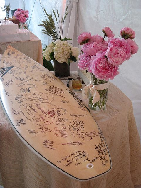 I LOVE this idea- using a surf board as a guest book. Then it would be so cool to display in mine and Stu's house.
