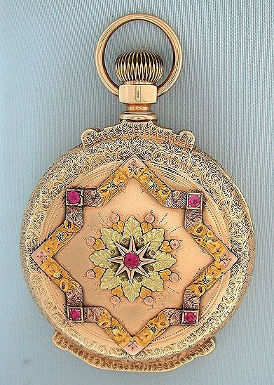 Beautiful Howard multicolor 14K gold and stone set box hinge antique pocket watch circa 1883. The engraved case with elaborate stone set designs in various colors of gold. White enamel dial with blued steel hands (hour hand replaced). Damascened 15 jewel adjusted nickel movement with screwed jewel settings and precision regulator. Handsome example.