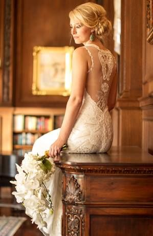 Fitted lace wedding dress with illusion back.
