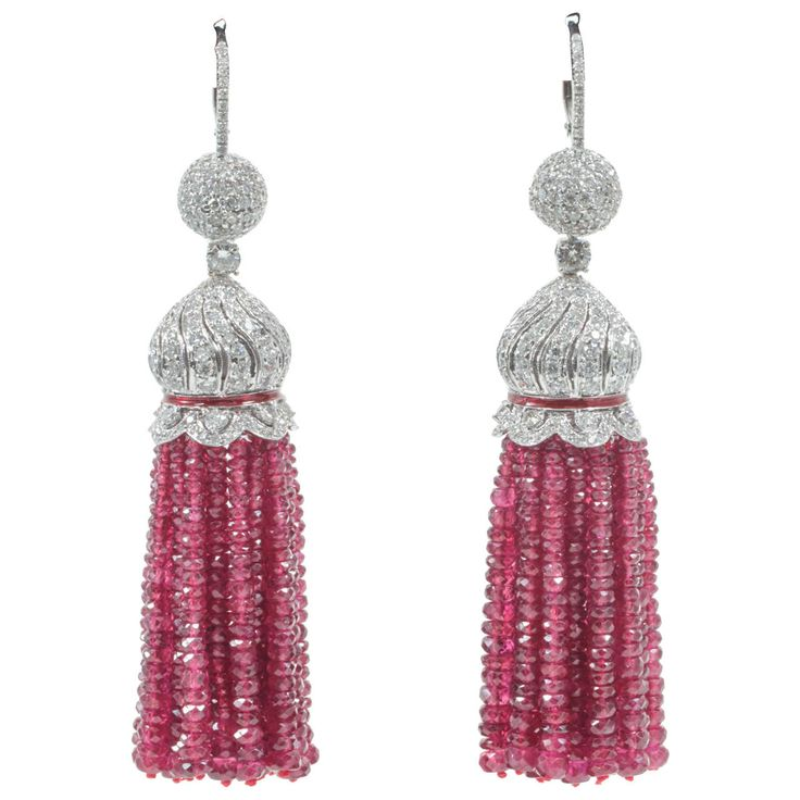 Two Hundred Carat Burma Ruby Beads Diamond Tassel Earrings. A beautiful piece of jewelry  200 carats of fine Burma Ruby Beads  7.95 carats of round brilliant cut diamonds  All set in 18k white gold. Over 3 inches in length.