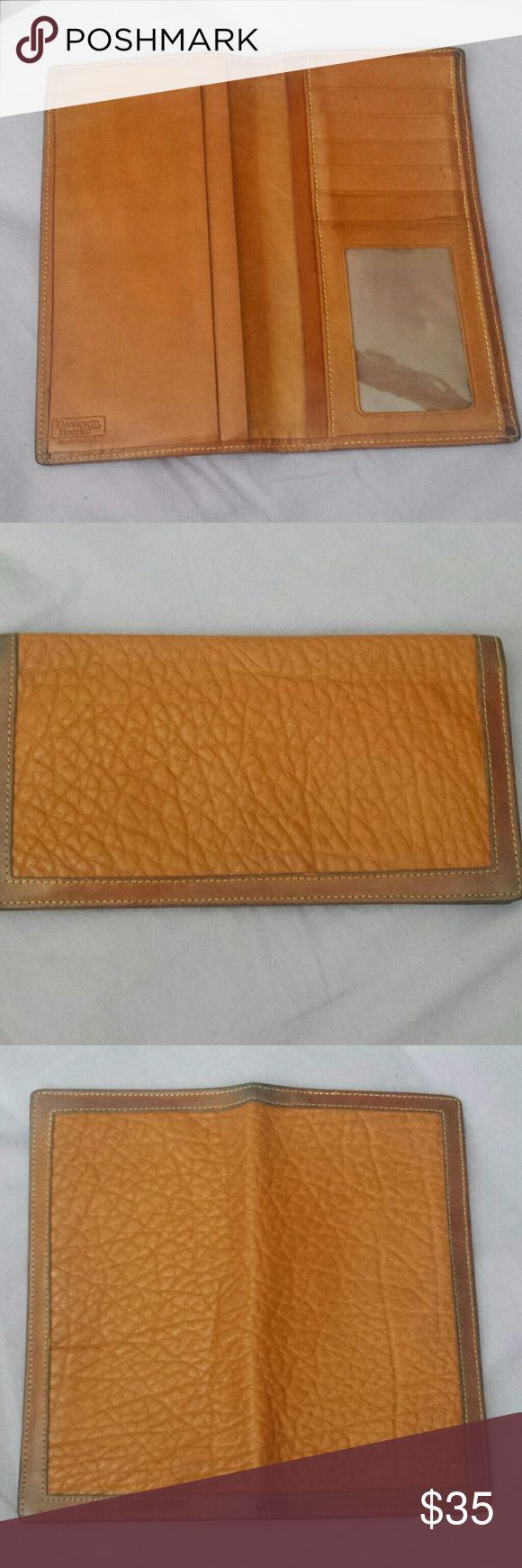 RARE mens DOONEY AND BOURKE checkbook wallet Rare men's checkbook wallet by Dooney and Bourke. Identification slot and 5 slots for cards, divided compartment for cash and receipts. In good shape, a little darkening on trim, minor pen marks. See pics Dooney & Bourke Bags Wallets