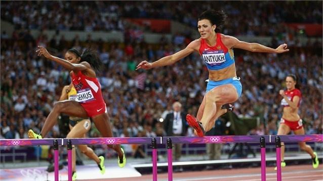 Natalya Antyukh of Russia crosses the finish line | the Women's 400m Hurdles Final | London 2012