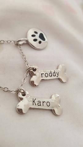 This gorgeous pendant necklace can be customized with the name of your dog!  Keep your favorite pooches close at all times! Add up to 2 dog names. Includes personalized bone charm, with additional pawprint charm and chain Length is 41+5cm Perfect gift for the dog parent!   Note: To ensure top quality, and a personal touch, please allow for additional processing time while we create your necklace with care (up to 12 days during peak periods)