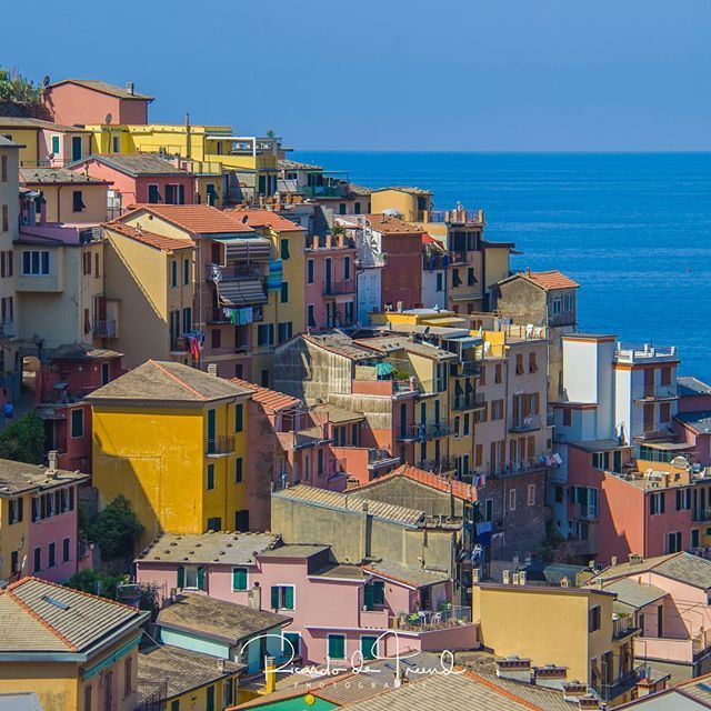 The cliff top township of Manarola enjoys beautiful views over the Mediterranean Sea in Cinque Terre. Its colourful houses are clustered spectacularly close on top of each other like most of the seaside villages on the coast of Liguria, Italy. ============================= Canon EOS 60D Canon EFs 18-200mm f/3.5 IS USM 70mm f/6.3 ISO 125 for 1/200 sec ============================== #ig_liguria #italian_places #through_italy  #Loves_United_liguria #volgoliguria #italy_vacations ig_italy  #f...