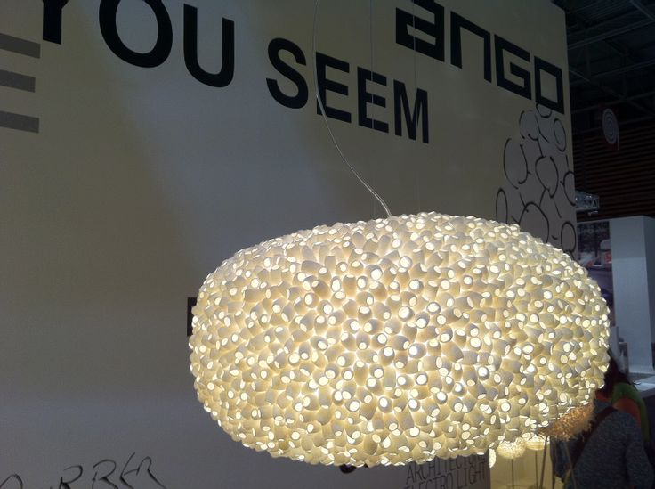 "EVOLUTION - haning lamp. Silk cocoons (two sides open) glued onto a inner polymer foam which allows a very good overall lighting ""output"". www.udogangl.com"