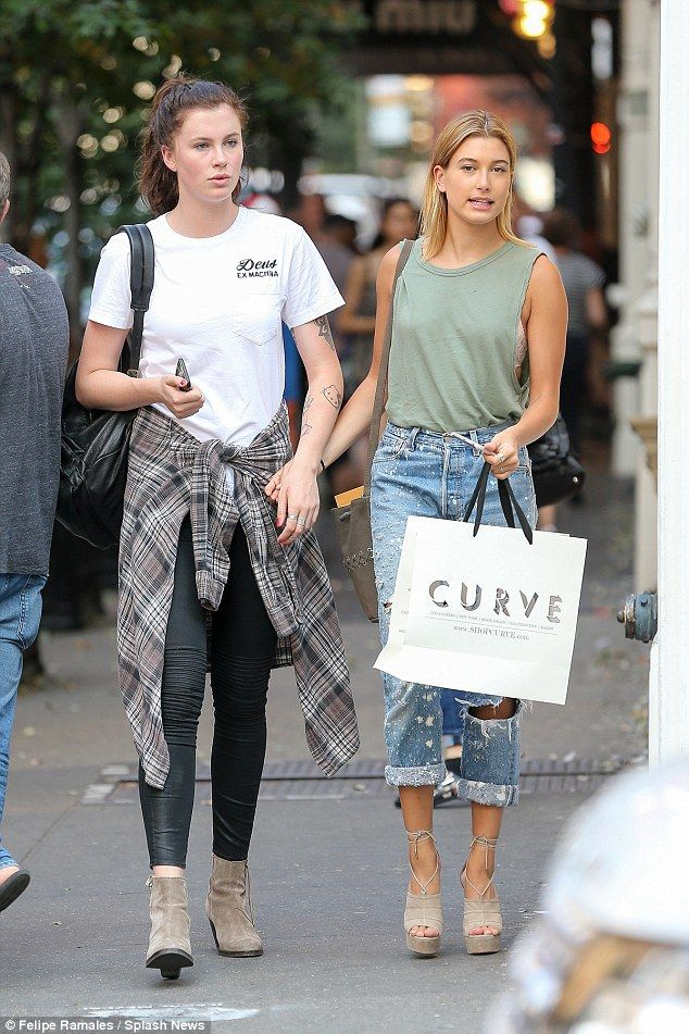 Out for a stroll: After sharing a friendly peck on the lips the night before at the Mission: Impossible premiere Ireland Baldwin and Hailey Baldwin were spotted out for a stroll on Tuesday in New York City