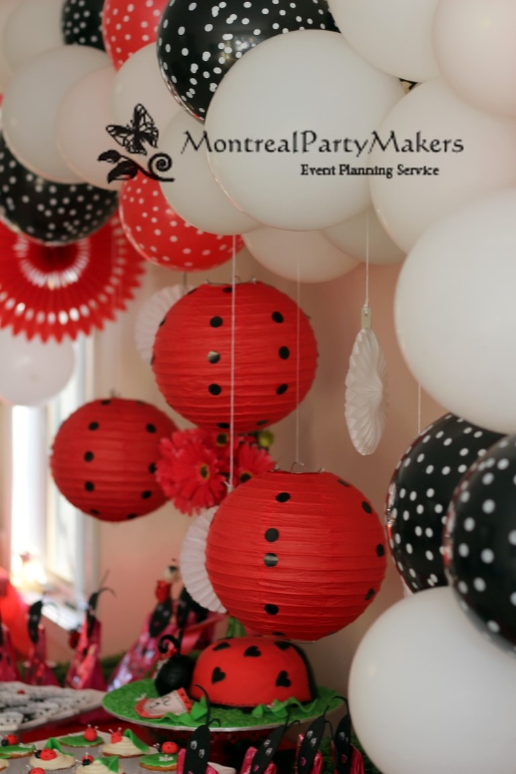 Ladybug Birthday Party..Love the red paper lanterns with black spots.
