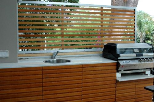 Outdoor BBQ  The externals have been properly treated to accommodate changing weather conditions. The cabinets have been made from 16mm 'Marine Ply' coated in a 2 pack acid cat. Timber slats have been adhered to the externals and give a decorative finish. 20mm Caesar stone used as the bench top.The BBQ is an Elite 4 burner available from BBQ's Galore.