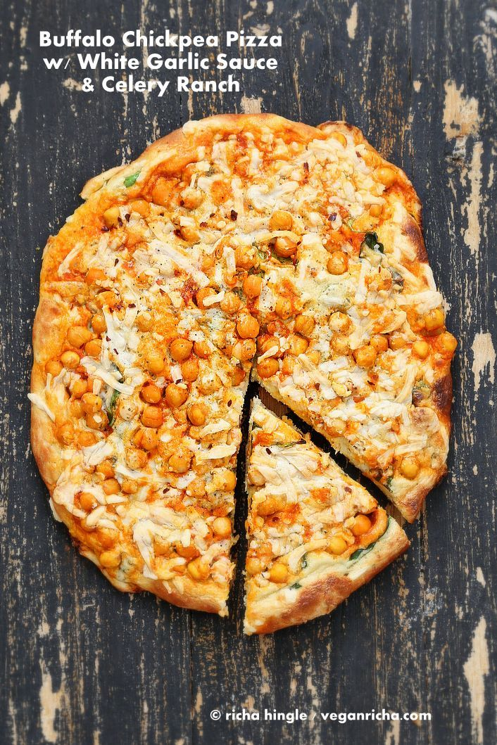 Buffalo Chickpea Pizza with White Garlic Sauce and Celery Ranch Dressing. Vegan Recipe