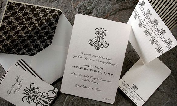 Nevis Letterpress. Black and Ivory invites with black calligraphy writing and an ivory envelope with a black patterned liner.
