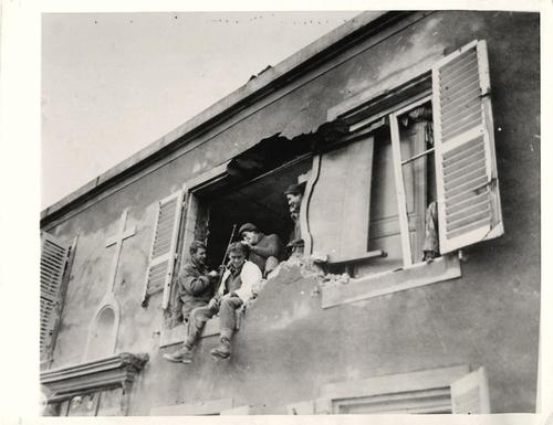 1944- What was once a bedroom of a home in Metz, France, is now being used as a barber shop by U.S. soldiers.