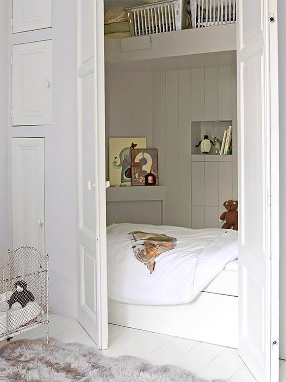 Closet sleeping nook in a kid's room