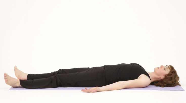 """This pose puts the body completely at rest. It trigger the body's """"relaxation response,"""" a state of deep rest that slows the breathing and lowers the blood pressure while quieting the nervous system. Take the time to be still in this pose for a few minutes. To get into the floor, lay flat on your back on your yoga mat or floor, and focus on taking slow, rhythmic breaths."""