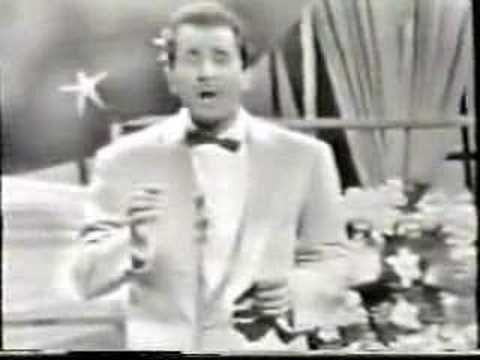 Volare - Domenico Modugno.   The one Italian song that everyone knows. This is the original 1958 version.   (Betcha didn't know it was the Italian entry in the Eurovision Song Contest !)