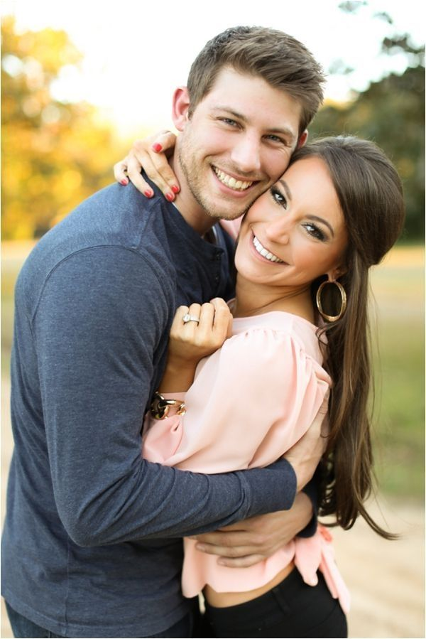 engagement pose - shows off the ring nicely. Adorable engagement shoot by Nina Maltese