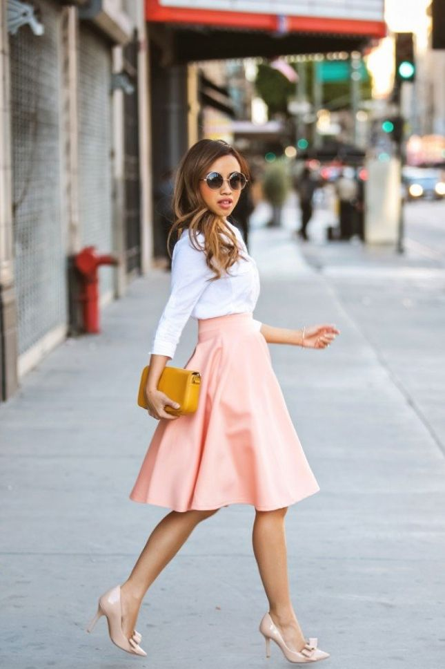 Pair a flowy skirt with a blouse and bow heels. So cute!