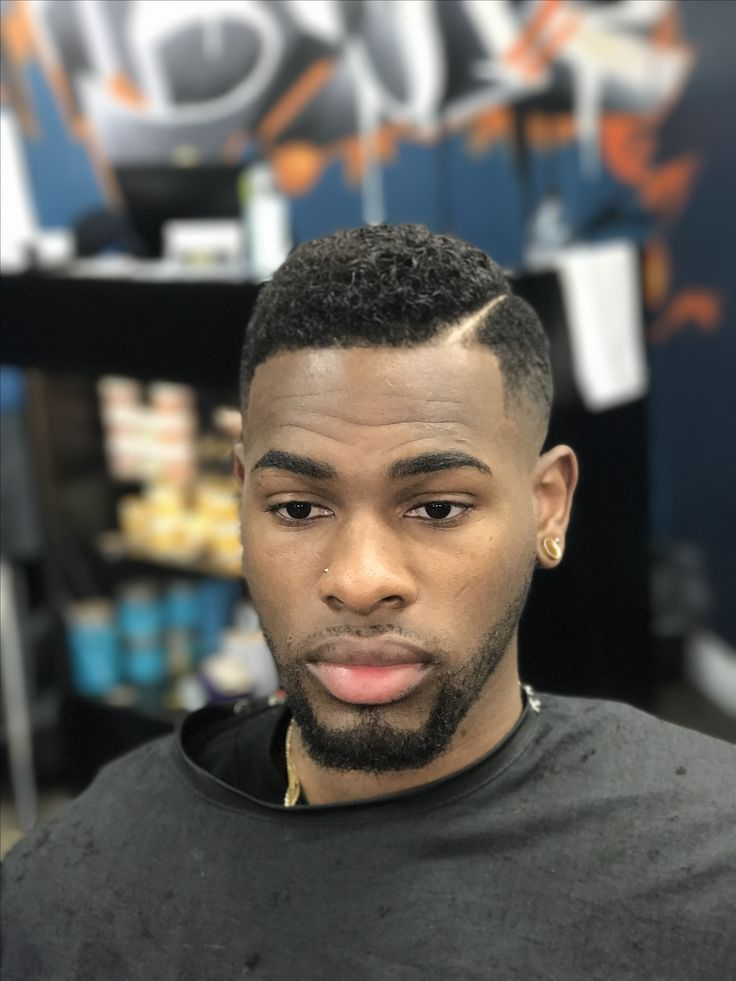 "Medium skin fade treated with a ""Curl-Over"""