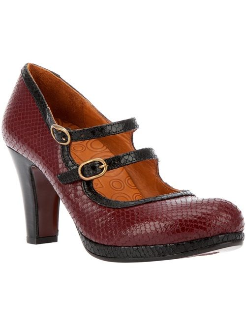 Red textured leather pump from Chie Mihara featuring a round toe, a blue leather covered platform, a leather sole, a tapered heel, a blue top trim, and two strap and buckle fastenings.